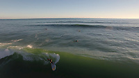 Aerial view of (SUP) standup paddle board surfing at Palliser Bay, Wairarapa, New Zealand