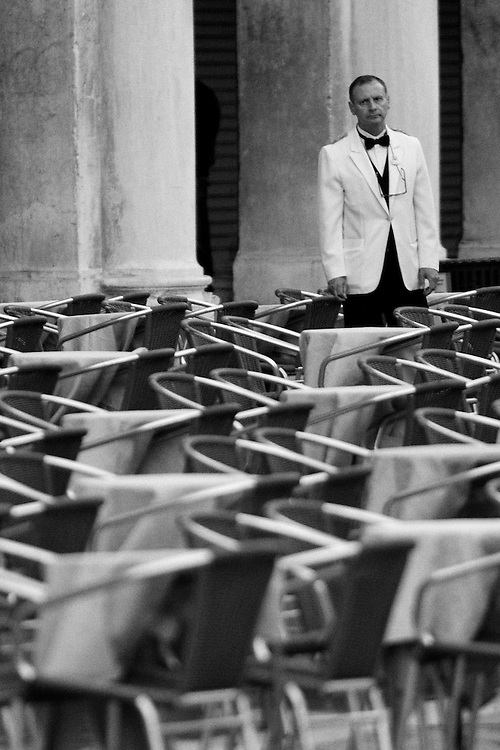 Before Lunch in Venice. Limited Edition 1 of 10. Black and white photo of a waiter just before lunch at Piazza San Marco in Venice Italy.