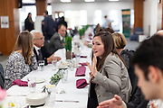 (Center) Faith Voinovich, a student trustee on the Board of Trustees and junior in chemical engineering, enjoys lunch and conversation at the grand opening and ribbon cutting for the new CoLab, October 18, 2018. (Photo by Stephen Zenner/Ohio University Libraries)
