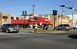 23 August 2015. New Orleans, Louisiana. <br /> Hurricane Katrina revisited. <br /> Cajun seafood on the bustling corner of Toledano St and South Broad Street a decade after the storm.<br /> Photo credit©; Charlie Varley/varleypix.com.