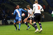 Kaid Mohamed and Darren Pratley battle during the The FA Cup Third Round Replay match between Bolton Wanderers and Eastleigh at the Macron Stadium, Bolton, England on 19 January 2016. Photo by Pete Burns.
