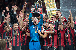 December 8, 2018 - Atlanta, Georgia, United States - Atlanta United goalkeeper BRAD GUZAN (1) lifts the MLS Cup with teammates during a post game celebration at Mercedes-Benz Stadium in Atlanta, Georgia.  Atlanta United defeats Portland Timbers 2-0 (Credit Image: © Mark Smith/ZUMA Wire)