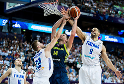 Gasper Vidmar of Slovenia between Matti Nuutinen of Finland and Gerald Lee of Finland  during basketball match between National Teams of Finland and Slovenia at Day 3 of the FIBA EuroBasket 2017 at Hartwall Arena in Helsinki, Finland on September 2, 2017. Photo by Vid Ponikvar / Sportida