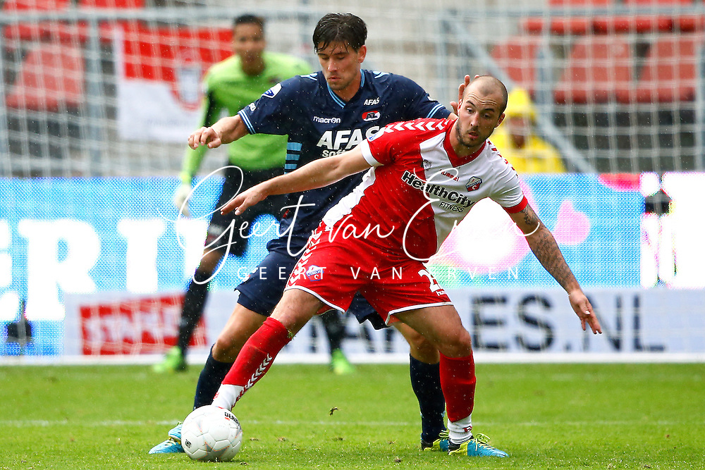 Onderwerp/Subject: FC Utrecht - AZ Alkmaar - Eredivisie<br /> Reklame:  <br /> Club/Team/Country: <br /> Seizoen/Season: 2013/2014<br /> FOTO/PHOTO: Steve DE RIDDER (R) of FC Utrecht in duel with Jan WUYTENS (L) of AZ Alkmaar. (Photo by PICS UNITED)<br /> <br /> Trefwoorden/Keywords: <br /> #04 $94 &plusmn;1371811811150<br /> Photo- &amp; Copyrights &copy; PICS UNITED <br /> P.O. Box 7164 - 5605 BE  EINDHOVEN (THE NETHERLANDS) <br /> Phone +31 (0)40 296 28 00 <br /> Fax +31 (0) 40 248 47 43 <br /> http://www.pics-united.com <br /> e-mail : sales@pics-united.com (If you would like to raise any issues regarding any aspects of products / service of PICS UNITED) or <br /> e-mail : sales@pics-united.com   <br /> <br /> ATTENTIE: <br /> Publicatie ook bij aanbieding door derden is slechts toegestaan na verkregen toestemming van Pics United. <br /> VOLLEDIGE NAAMSVERMELDING IS VERPLICHT! (&copy; PICS UNITED/Naam Fotograaf, zie veld 4 van de bestandsinfo 'credits') <br /> ATTENTION:  <br /> &copy; Pics United. Reproduction/publication of this photo by any parties is only permitted after authorisation is sought and obtained from  PICS UNITED- THE NETHERLANDS