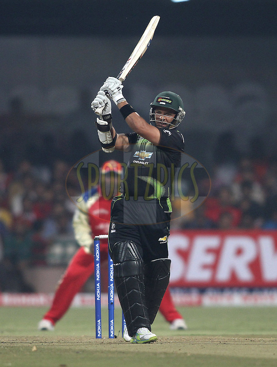 Ashwell Prince of the Warriors hits over the top  during match 1 of the NOKIA Champions League T20 ( CLT20 )between the Royal Challengers Bangalore and the Warriors held at the  M.Chinnaswamy Stadium in Bangalore , Karnataka, India on the 23rd September 2011..Photo by Shaun Roy/BCCI/SPORTZPICS