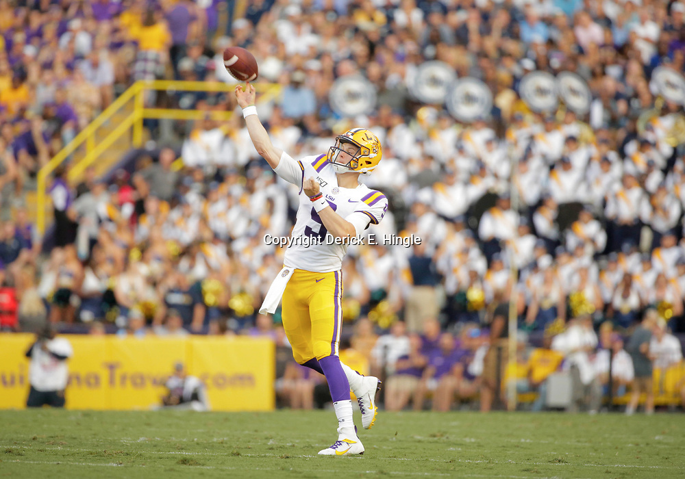 Aug 31, 2019; Baton Rouge, LA, USA; LSU Tigers quarterback Joe Burrow (9) throws a touchdown against the Georgia Southern Eagles during the first quarter at Tiger Stadium. Mandatory Credit: Derick E. Hingle-USA TODAY Sports