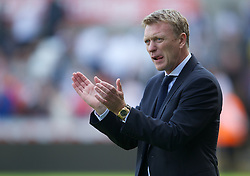 SWANSEA, WALES - Saturday, September 22, 2012: Everton's manager David Moyes applauds his side off after the 3-0 victory over Swansea City during the Premiership match at the Liberty Stadium. (Pic by David Rawcliffe/Propaganda)