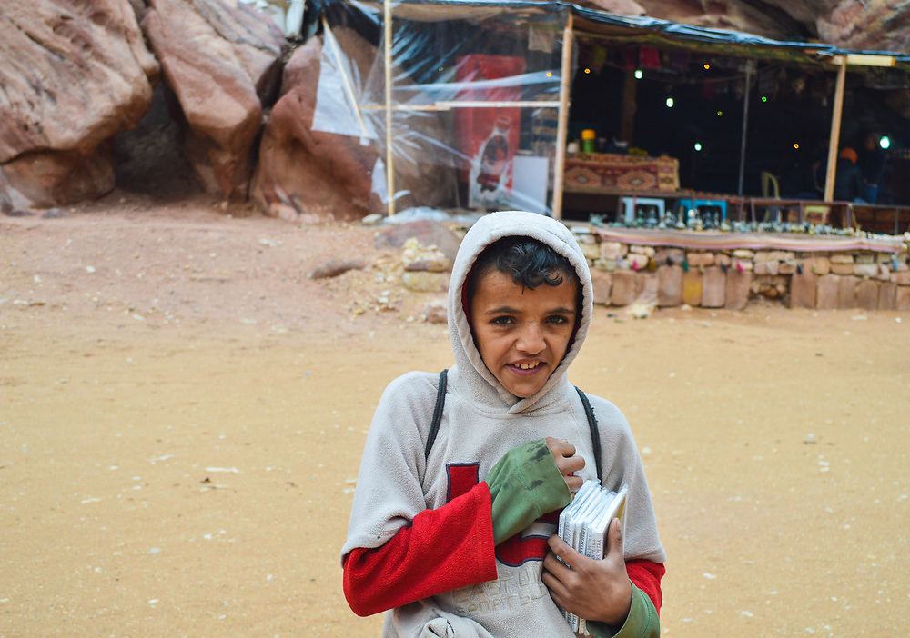 In the ancient ruins of Petra kids like to beg for money or always are trying to sale you something.