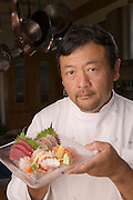 Sushi chef Ken Tominaga of Hana and Go Fish restaurants prepares sushi at the home of Go Fish partner and chef Cindy Pawlcyn in the Napa Valley, CA.