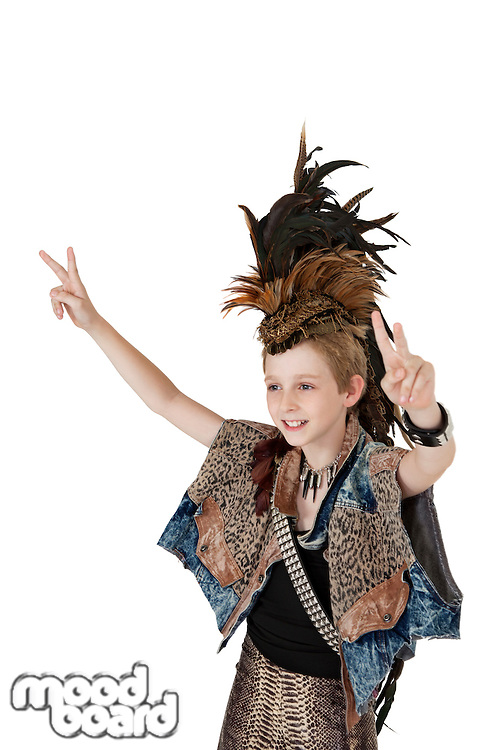 School kid in costume gesturing peace sign over white background