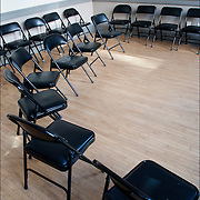 Empty room with chair in circle before the start of New Beginnings, a 12 step program for substance treatment abuse  designed to address issues in a holistic way to assist individuals to establish and maintain a lifestyle free of substance use,