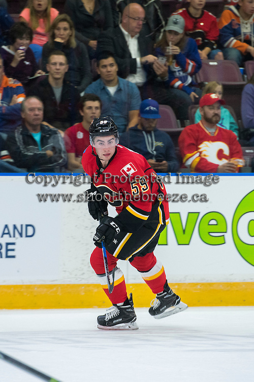 PENTICTON, CANADA - SEPTEMBER 17: Dillon Dube #59 of Calgary Flames skates against the Edmonton Oilers on September 17, 2016 at the South Okanagan Event Centre in Penticton, British Columbia, Canada.  (Photo by Marissa Baecker/Shoot the Breeze)  *** Local Caption *** Dillon Dube;