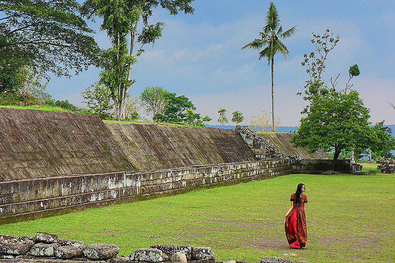 Woman walks through Ratu Boko Temple