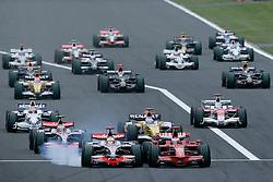 SHIZUOKA, JAPAN - Sunday, October 12, 2008: Lewis Hamilton (GBR, Vodafone McLaren Mercedes) and Kimi Raeikkoenen (FIN, Scuderia Ferrari Marlboro) clash during the Japanese Formula One Grand Prix at the Fuji Speedway. (Photo by Michael Kunkel/Hochzwei/Propaganda)
