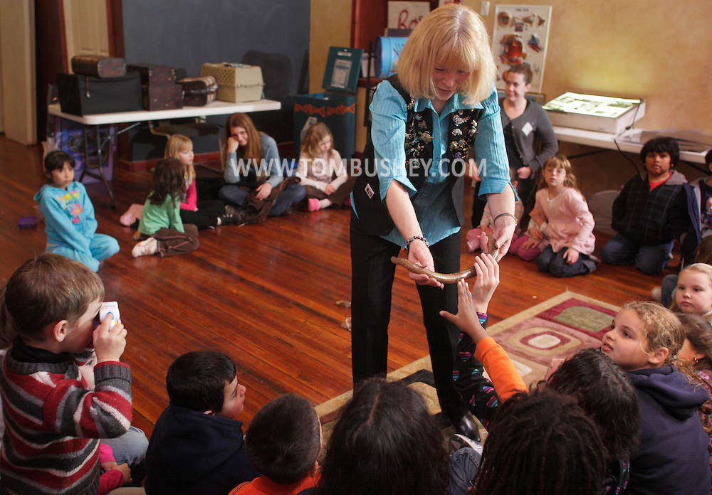 "Middletown, NY - Jan Berlin, director of Everything Animals Resource Center, shows a legless lizard to children at the Interactive Museum during her program ""Live Animals from Around the World"" on Feb. 7, 2010."