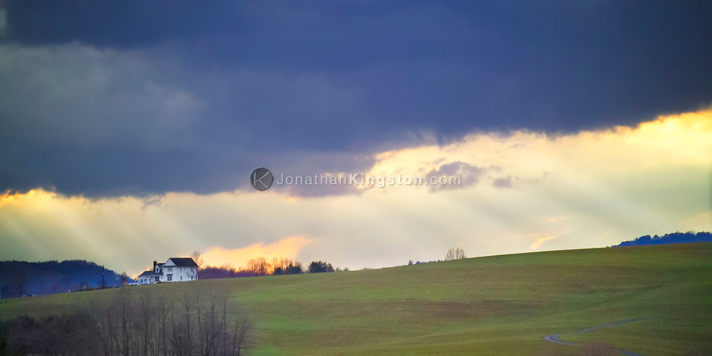 A spring storm casts shafts of light on ridge top home in Floyd, Virginia.