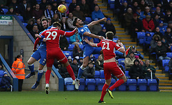 Ryan Tafazolli of Peterborough United challenges for the ball with Kyle Wootton and Cameron Burgess of Scunthorpe United - Mandatory by-line: Joe Dent/JMP - 01/01/2019 - FOOTBALL - ABAX Stadium - Peterborough, England - Peterborough United v Scunthorpe United - Sky Bet League One