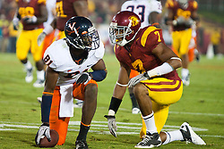 September 11, 2010; Los Angeles, CA, USA;  Virginia Cavaliers wide receiver Dontrelle Inman (81) is tackled by Southern California Trojans safety T.J. McDonald (7) after a pass reception during the fourth quarter at the Los Angeles Memorial Coliseum. USC defeated Virginia 17-14.