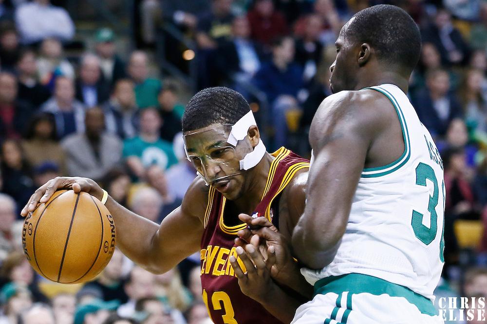 19 December 2012: Cleveland Cavaliers power forward Tristan Thompson (13) drives past Boston Celtics power forward Brandon Bass (30) during the Boston Celtics 103-91 victory over the Cleveland Cavaliers at the TD Garden, Boston, Massachusetts, USA.