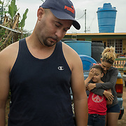 OCTOBER 18 - MARICAO, PUERTO RICO - <br /> Argenis Ramos, 34, his wife Karian Batista, 30, and daughter Yarelis Ramos, 9,  lost their house  to the destructive path of hurricane Maria in the Indiera Baja neighborhood.<br /> (Photo by Angel Valentin for NPR)