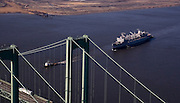 Aerial views of the USS Seattle Sailing under the Delaware Memorial Bridge