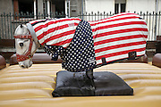 fairground bucking horse with American flag
