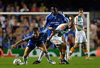 Photo: Daniel Hambury.<br />Chelsea v Werder Bremen. UEFA Champions League, Group A. 12/09/2006.<br />Chelsea's John Obi Mikel and Joe Cole combine to stop Bremen's Mohamed Zidan.