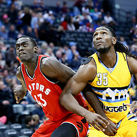 18 November 2016: Toronto Raptors forward Pascal Siakam (43) vies for the rebound with Denver Nuggets forward Kenneth Faried (35) during the Toronto Raptors 113-111 OT victory over the Denver Nuggets, at the Pepsi Center, Denver, Colorado, USA.