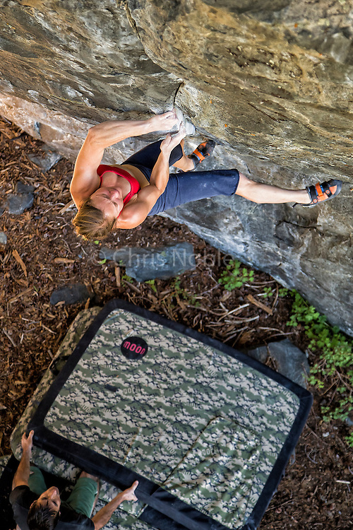 "Professional climber Lisa Rands working on ""The Seam"" a boulder problem rated V10, at the ""Way Lake"" boulders near Mammoth Lakes California."