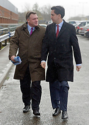 © Licensed to London News Pictures. 27/11/2012. Stevenage, UK Ed Miliband MP (Right), Leader of the Labour Party and Ed Balls MP (left), Labours Shadow Chancellor arrive in heavy rain to hold a joint question and answer session, today 27th November 2012, ahead of the Autumn Statement. Photo credit : Stephen Simpson/LNP