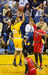 Feb 18, 2017; Morgantown, WV, USA; West Virginia Mountaineers forward Esa Ahmad (23) shoots a jumper while guarded by Texas Tech Red Raiders forward Anthony Livingston (21) during the second half at WVU Coliseum. Mandatory Credit: Ben Queen-USA TODAY Sports