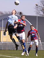FODBOLD: Jonas Kallehauge (Helsingør) i duel med anfører Mathias Potoker (Frem), med Driton Murati (Frem) i baggrunden, under kampen i Danmarksserien, pulje 1, mellem Elite 3000 Helsingør og Boldklubben Frem den 25. april 2010 på Helsingør Stadion. Foto: Claus Birch