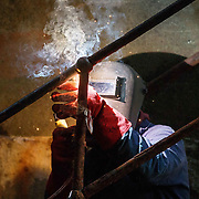 LEITH, SCOTLAND - JANUARY 25: A welder at work in Leith's Imperial Dry Dock as Scottish Government announce the second round of funding for the Decommissioning Challenge Fund Worth a total of £1.5 million, funding will be awarded to companies to deliver the decommissioning of North Sea oil and gas infrastructure on January 25, 2018 in Leith, Scotland. (Photo by Robert Perry/Getty Images)