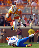 September 18,2010: Tennessee Volunteers tight end Luke Stocker (88) leaps over Florida Gators cornerback Jeremy Brown (8) during the game at Neyland Stadium in Knoxville, Tennessee. The Gators won, 31-17.