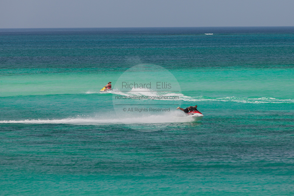 People ride jet skis  in Nassau, Bahamas.