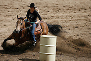 062109-Evergreen, Colo.-barrelracing-during the 2009 Evergreen Rodeo PRCA Barrel Racing Competition Sunday, June 21, 2009 at The Evergreen Rodeo Grounds..Photo By Matthew Jonas/Evergreen Newspapers/Photo Editor