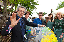 © Licensed to London News Pictures. 04/06/2016. Hay-on-Wye, Powys, Wales, UK.  Piers, with his 'beach ball' globe, talks to members of the audience over coffee. Controversial Climatologist/Meteorologist Piers Corbyn, brother of the Labour leader, Jeremy Corbyn, gives a presentaion at the Globe site,about the hoax of man made global warming on the tenth day of 'HowTheLightGetsIn' Festival of Ideas - The philosophy and music festival at Hay-on-Wye, Wales, UK. HowTheLightGetsIn festival was founded by post-realist philosopher and director of the Institute of Art and Ideas, Hilary Lawson. Photo credit: Graham M. Lawrence/LNP