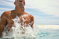 Man surfacing in swimming pool half length cropped