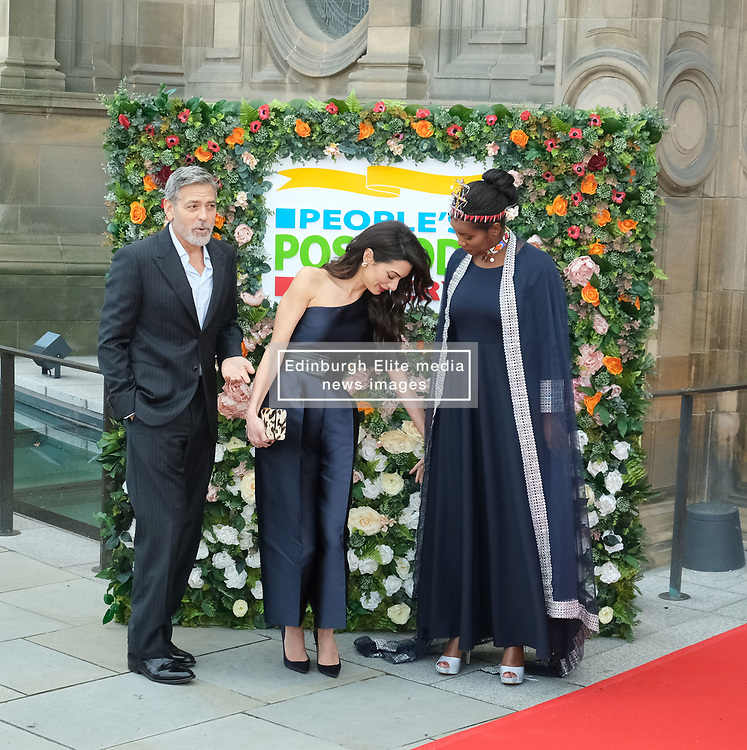 George Clooney and his wife Amal, representing the Clooney Foundation for Justice, arrive to collect an award for their charity work at the People's Postcode Lottery Charity Gala in Edinburgh <br /> <br /> Pictured: George Clooney and wife Amal Clooney <br /> <br /> (c) Aimee Todd   Edinburgh Elite media