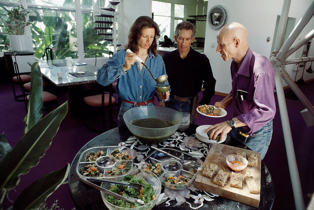 Biosphere 2 Project undertaken by Space Biosphere Ventures, a private ecological research firm funded by Edward P. Bass of Texas.  'Biospherian's' Jane Poynter, Mark Nelson and Roy Walford eating lunch inside Biosphere 2. Walford authored a book titled The Anti-Aging Plan. He died in 2004 at age 79 of ALS. Biosphere 2 was a privately funded experiment, designed to investigate the way in which humans interact with a small self-sufficient ecological environment, and to look at possibilities for future planetary colonization.1992