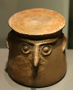Lids with anthropomorphic faces or band handles. Ceramic 2600-1700 BC.