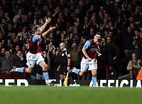 Photo: Mark Stephenson/Sportsbeat Images.<br /> Aston Villa v Tottenham Hotspur. The FA Barclays Premiership. 01/01/2008.Villa's Martin Laursen (L) celebrates his goal for 2-1 while Gareth Barry looks on