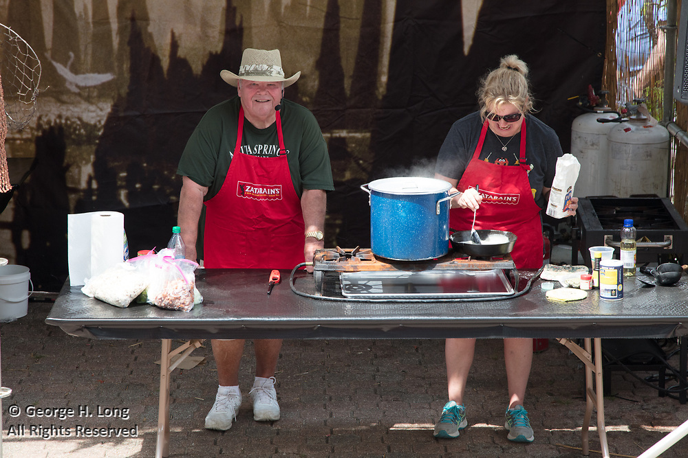 Bryan Gowland and family make their chicken and andouille gumbo at the Zatarain's stage at the New Orleans Jazz and Heritage Festival on April 28, 2017