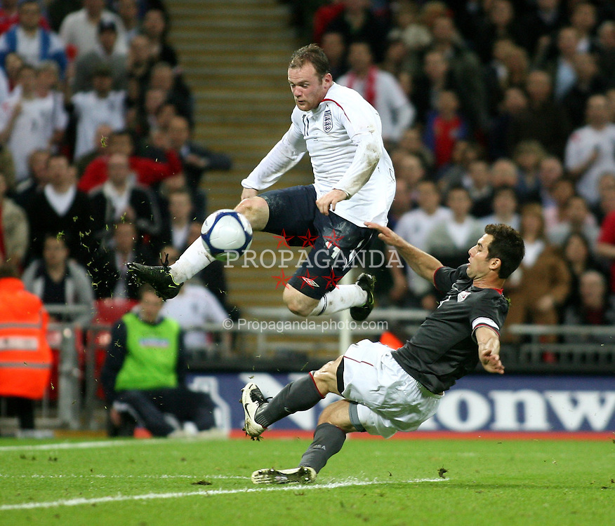 London, England - Wednesday, May 28, 2008: England's Wayne Rooney in action against USA's Carlos Bocanegra at Wembley Stadium. (Pic by Chris Ratcliffe/Propaganda)