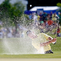 Apr 29, 2012; Avondale, LA, USA; Ernie Els hits from a bunker of the 18th hole during the final round of the Zurich Classic of New Orleans at TPC Louisiana. Mandatory Credit: Derick E. Hingle-US PRESSWIRE