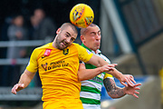 Scott Robinson (#17) of Livingston FC and Scott Brown (#8) of Celtic FC contest a header during the Ladbrokes Scottish Premiership match between Livingston FC and Celtic FC at The Tony Macaroni Arena, Livingston, Scotland on 6 October 2019.