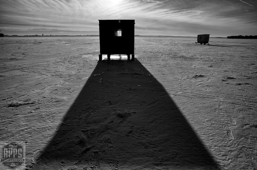 Shadow from an ice fishing shack on Lake Mendota in Madison, Wisconsin Sunday, Jan. 15, 2017