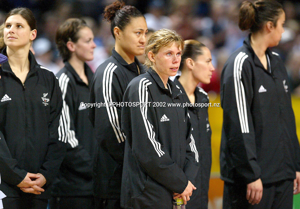 4th August, 2002. Manchester Evening News Arena. Women's Netball Final. New Zealand v Australia.<br />A sad Julie Seymour looks on as Australia celebrate.<br />Australia won the match in extra time, 57-55.<br />Credit: Andrew Cornaga/Photosport.