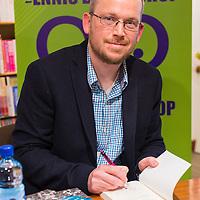 Pádraig Óg Ó Ruairc signing a copy of his book 'The Men Will Talk To Me' at Ennis Bookshop