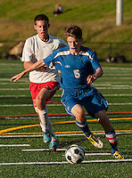 Laconia's Brayden Harriman and Interlakes Sam Otis charge down field during Tuesday nights NHIAA Division III Soccer.  (Karen Bobotas/for the Laconia Daily Sun)